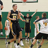 Record-Eagle/Jan-Michael Stump<br /> Traverse City Central's Tanner Kenney (22) and teammates celebrate Monday's 42-29 win over Traverse City West.