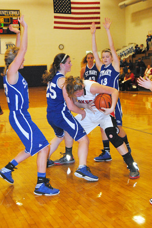 Record-Eagle/James Cook<br /> Gaylord St. Mary players swarm Bear Lake's Emileigh Ferguson.