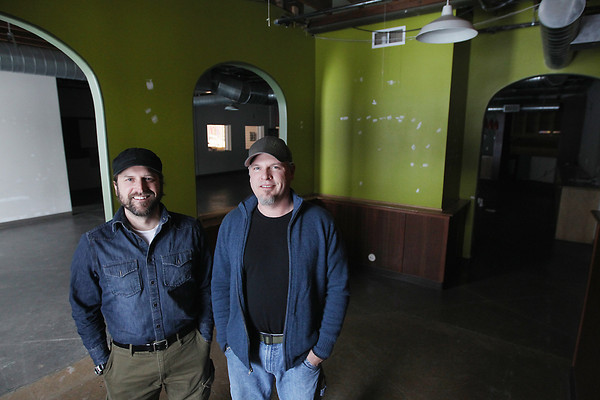 Record-Eagle/Keith King<br /> Pete Kirkwood, left, founder, and Corey Wentworth, brewer, stand Friday, February 22, 2013 in the space, which was once the location of Right Brain Brewery, they plan to use for The Workshop Brewing Company in Traverse City's Warehouse District.