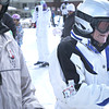 Record-Eagle/Nathan Payne<br /> George L. Petritz and Lou Batori wait their turn to board a chairlift at Crystal Mountain Resort and Spa on Monday for Batori's second ski run of the season.
