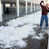 Record-Eagle/Andy Taylor<br /> Traverse City Beach Bums' Maintenance Director Ken Allen shovels snow off the seating area at Wuerfel Park.