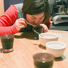 Record-Eagle/Keith King<br /> Jennifer Yeatts, director of marketing and quality assurance, breathes in a coffee's aromatics as she conducts a coffee cupping, after delivering a roastery tour at Higher Grounds Coffee Bar and Roastery in Traverse City.