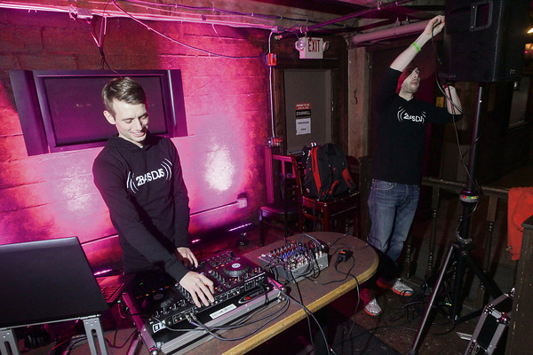 Record-Eagle/Keith King<br /> Scott Perry, left, owner of 2Bays DJs, and Alex Gusler, a disc jockey with 2Bays DJs, set up equipment in preparation for a performance at Kilkenny's Irish Public House in Traverse City.