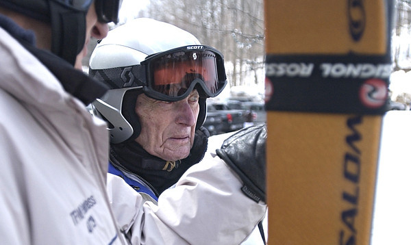Record-Eagle/Nathan Payne<br /> Lou Batori talks with George L. Petritz before the pair made their way to the chairlift Monday afternoon. Batori, 103, has been skiing for 93 years.