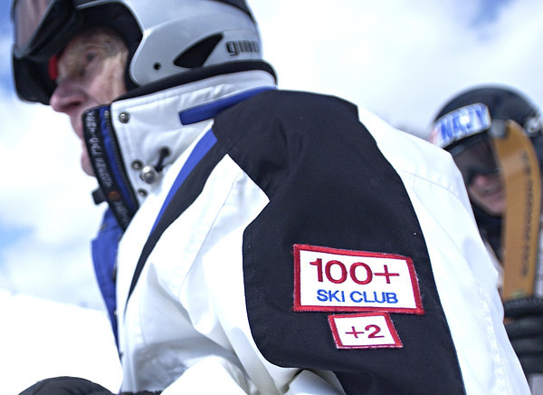 Record-Eagle/Nathan Payne<br /> Lou Batori wears two patches on the arm of his ski jumpsuit - one for the 100-plus club and a second one he adds for each year he skis.