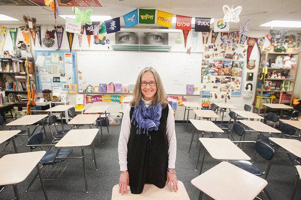 Record-Eagle/Keith King<br /> Terri Reisig, teacher, stands in her classroom Friday at Elk Rapids High School.