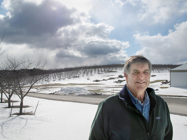 Record-Eagle/Glenn Puit <br /> Fruit farmer Don Gregory stands in front of Cherry Bay Orchards in Leelanau County. Gregory said he's seeing increased damage to fruit trees from deer. The male deer, or bucks, are increasingly rubbing their antlers against trees, destroying them.