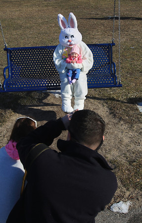 Record-Eagle/Keith King<br /> Lillian Underwood, nine months, of Frankfort, smiles as she has her picture taken with the Easter Bunny by her father Brandon Underwood, as her mother, Kristina Underwood, stands near Saturday, March 30, 2013 prior to the start of the annual Easter Egg Hunt at Mineral Springs Park in Frankfort.