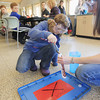 Record-Eagle/Keith King<br /> Aubree Delancey, 8, of Traverse City, with the help of Courtney Bierschbach, Grand Traverse Conservation District education coordinator, prepare to launch a rocket using water and an effervescent tablet Thursday, March 28, 2013 as part of a spring break program at the Boardman River Nature Center. The program takes place each day this week with a different theme each day. The rocket was made using a 35mm film canister and paper with a dragonfly nymph on it with the focus on the experiment aimed at teaching how dragonfly nymphs are able to absorb water and force it out quickly to take off like a rocket in order to elude predators.