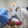 Record-Eagle/Keith King<br /> Dr. Allen Hoeft, left, and Daniel Fragnoli, right, University of Michigan School of Dentistry student, work with patient Kandice Carr, of Fife Lake, Tuesday, April 2, 2013 at the Northwest Michigan Health Services Dental Clinic in Elmwood Township.