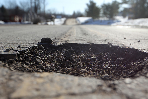 Record-Eagle/Jan-Michael Stump<br /> Potholes on East Bay Township's Holiday Road may soon be repaired.