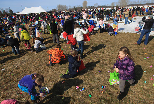 Record-Eagle/Keith King<br /> Participants gather eggs Saturday, March 30, 2013 during the Easter Egg Hunt at West Side Community Church in Solon Township. Over 32,000 eggs were filled by members of the church congregation and donated for the  event.