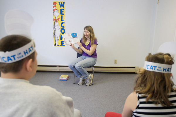 "Record-Eagle/Keith King<br /> Betsy Schaub, assistant librarian, reads ""The Cat in the Hat,"" Saturday, March 30, 2013 at a ""Cat in the Hat"" party to celebrate Dr. Seuss's birthday during story hour at the Betsie Valley District Library in Thompsonville."