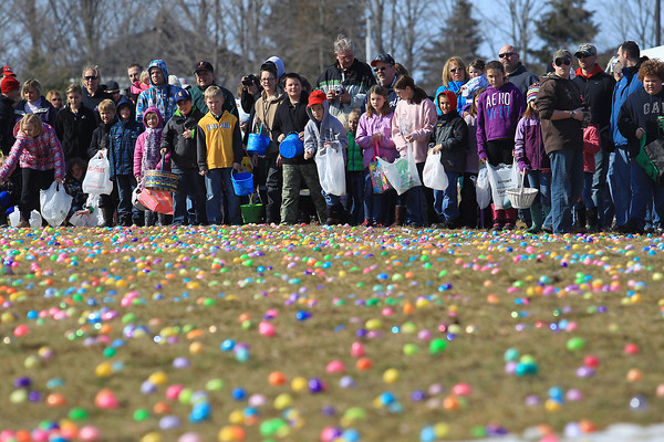 Record-Eagle/Keith King<br /> Participants wait Saturday, March 30, 2013 for the start of the Easter Egg Hunt at West Side Community Church in Solon Township. Over 32,000 eggs were filled by members of the church congregation and donated for the  event.