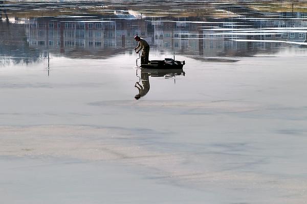SUNNY ICE FISHERMAN