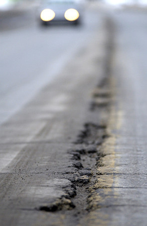 Record-Eagle/Nathan Payne<br /> Wide cracks line the center of Cass Road south of the Traverse City limits in a section of road slated for reconstruction.