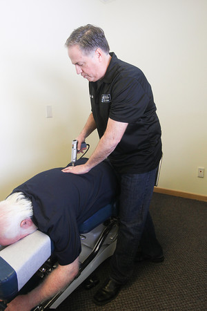 Record-Eagle/Keith King<br /> Dr. Rick Murphy works with Michael Parrish, of Traverse City, Monday at Traverse City Chiropractic Life Center.