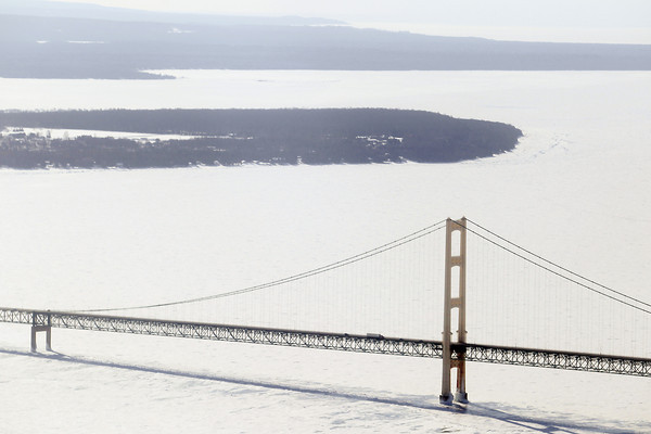 Record-Eagle/Keith King<br /> <br /> The Mackinac Bridge as well as ice in the Straits of Mackinac are visible Tuesday.
