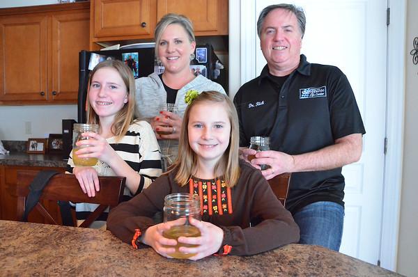 "Record-Eagle/Allison Batdorff<br /> The Murphy family considers kombucha the family ""nightcap."" Center to left: Tatum, 11, Quinn, 13, Audri and Rick Murphy in their Traverse City home."