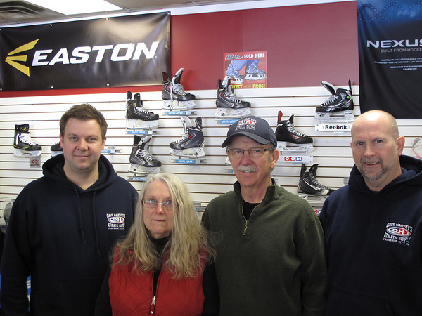 Record-Eagle/Glenn Puit <br /> The prior and new owners of Dave Harvey's Athletic Supplies. From left to right are Chris Street, Lin and Dave Harvey and Chad Helton. The Harveys are selling the business to Street and Helton after 32 years in business.