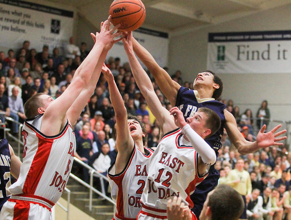 Record-Eagle/Keith King<br /> East Jordan's Jordan Weber (32), from left, Colin Petrie (24) and Donny Cutler (12) along with Traverse City St. Francis' Dylan Sheehy (33) battle for the ball Monday at Traverse City St. Francis High School.