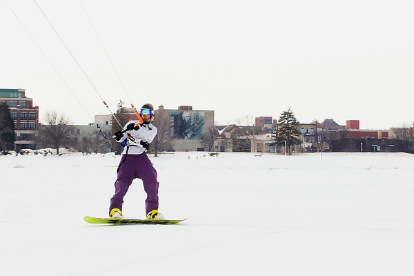 Record-Eagle/Keith King<br /> Cam Davis, of Traverse City, snowkites Friday near the Clinch Park boat launch on West Grand Traverse Bay as he and others snowkite toward the end of Old Mission Peninsula.