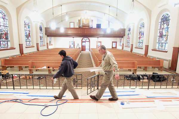 Record-Eagle/Keith King<br /> Michael Rodriguez, left, and Brian Black, both with Grand River Builders, move a section of marble Friday that is to be used on the altar rail at Holy Rosary Catholic Church in Centerville Township.