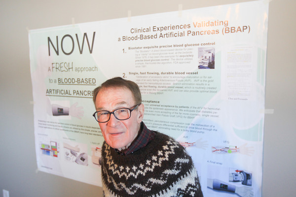 Record-Eagle/Keith King<br /> Arnold Landé, M.D., of Northport, stands near a poster which explains his Blood-Based Artificial Pancreas (BBAP).