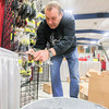 Record-Eagle/Keith King<br /> Jim Jackson, co-owner of Fishing Complete Inc., displays soft plastic fishing lures Thursday as preparations are made at the Grand Traverse County Civic Center for the Traverse City Hunting and Fishing Expo scheduled for Friday, Saturday and Sunday.