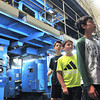 Record-Eagle/Nathan Payne<br /> Students from three Willow Hill Elementary School fourth-grade classes walk through the Record-Eagle press room after learning the newspaper's printing press can produce 10,000 copies of the publication per hour. Teachers Candiss Brewer, Mary Jane Collins and Erin Jongekrijg brough their students to the newspaper plant Monday morning where they toured the printing and distribution operation from start to finish.