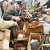 Record-Eagle/Keith King<br /> Ron Fredrick, of Big Rapids, reaches for a miter box among other items he has for sale during the Buckley Old Engine Show Spring Swap Meet at the Buckley Old Engine Show grounds. The event is scheduled through Saturday.