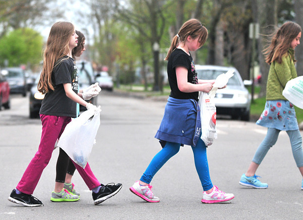 Record-Eagle/Nathan Payne<br /> Members of the Central Grade School Girls on the Run team head back toward the school after picking up trash in the neighborhood around the school. The club combines training for running races with community service for the 80 girls at the school who participate.