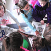 Record-Eagle/Nathan Payne<br /> Students from three Willow Hill Elementary School fourth-grade classes grab copies of the Record-Eagle at the end of a tour of the newspaper's production plant. The students got an inside look at the press and distribution operation of the daily newspaper.