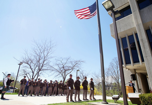 Record-Eagle/Keith King<br /> The American Flag flies at half-staff Wednesday, May 15, 2013 during the Peace Officers Memorial Day ceremony at the Governmental Center in Traverse City. Members of area police, sheriff and fire departments as well as the United States Coast Guard were in attendance for the ceremony which recognizes fallen peace officers.