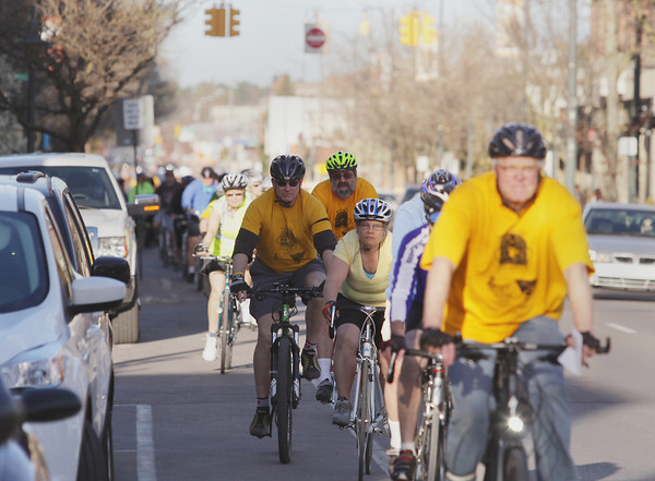 Record-Eagle/Keith King<br /> Bicyclists travel on Front Street through downtown Traverse City Wednesday, May 15, 2013 at the start of the Traverse City Ride of Silence to raise awareness among motorists, cyclists, police, city officials and residents. Bicyclists take to the streets in a slow, silent procession to honor cyclists who have been killed or injured while riding on public roads. The Cherry Capital Cycling Club and TART Trails sponsor the annual ride.