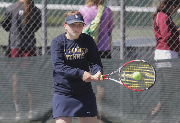 Record-Eagle/Keith King<br /> Traverse City St. Francis' Amanda Bandrowski competes at number one singles Thursday, May 16, 2013 at Traverse City Central High School.