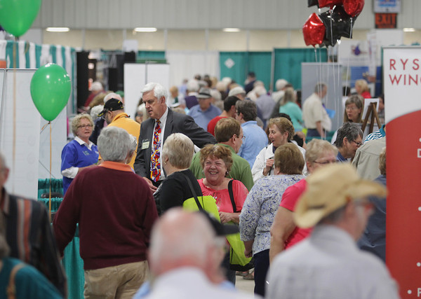 Record-Eagle/Keith King<br /> Attendees and exhibitors gather Wednesday, May 15, 2013 during the Ideas for Life Senior Expo, presented by Bay Area Senior Advocates, in Howe Arena at the Grand Traverse County Civic Center. Profits from the event are to be administered by the Grand Traverse County Commission on Aging for area seniors in need.