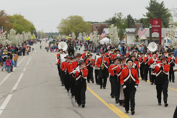 Record-Eagle/Keith King<br /> The Mesick Bulldog Marching Band travels on Mesick Avenue as part of the Mushroom Festival Grand Parade Saturday, May 11, 2013, during the annual Mesick Mushroom Festival.