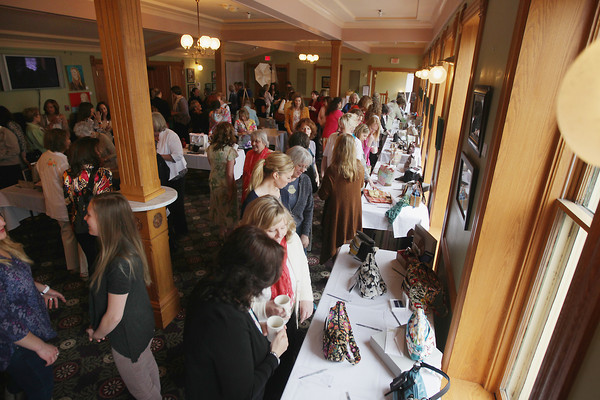 Record-Eagle/Keith King<br /> Attendees gather and mingle near items placed on tables for a silent auction Saturday, May 11, 2013 during the Power of the Purse event at the City Opera House to benefit women and families staying at the Goodwill Inn.