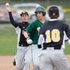 Record-Eagle/Jan-Michael Stump<br /> Traverse City West's Joe Caraccio is chased down by Traverse City Central's Colin Casey and third baseman Josh Tyrer in the first game of a double-header.