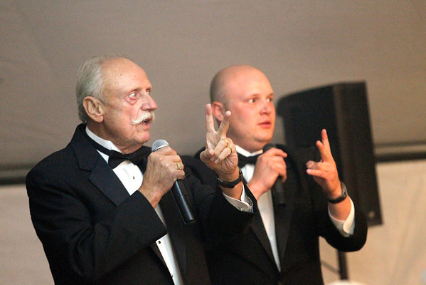 Record-Eagle/Jan-Michael Stump<br /> Jerry Cole, left, and his son Grant Cole run the auction during Thursday's Ancient Order of Hibernians Fr. Fred Foundation Cigar Dinner. About 300 guests were treated to a gourmet dinner prepared by more than a dozen of the Grand Traverse area's chefs, paired with cigars and wine. The event raised more than $72,000 for the foundation last year, and hoped to raise as much as $100,000 this year from ticket sales, raffles, an auction and donations.
