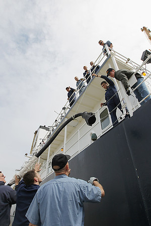Record-Eagle/Keith King<br /> Great Lakes Maritime Academy (GLMA) cadets and crew disconnect a shore power line and lower it onto the dock.