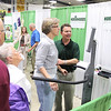 "Record-Eagle/Keith King<br /> David Rapson, board certified physical therapist and owner of Northwoods Physical Therapy, talks with Joyce Tkach as she stands on a machine that assesses an individual's balance Wednesday, May 18, 2011 during the 10th annual Ideas for Life Senior Expo at the Grand Traverse County Civic Center. The event was sponsored by the Bay Area Senior Advocates (BASA). ""It's nice having everything in one spot and getting information,"" Tkach said."