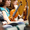 Record-Eagle/Jan-Michael Stump<br /> Traverse City West students Katie Zagore, left, and Nicole Martell brought their violins to represent their school's orchestra during the TCAPS Board meeting.