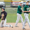 Record-Eagle/Jan-Michael Stump<br /> Traverse City West second baseman Jimmy Rinehart, center, and shortstop Ben Casciano (7), react after tagging out Traverse City Central's Joe Prokes at second in the first game Tuesday.