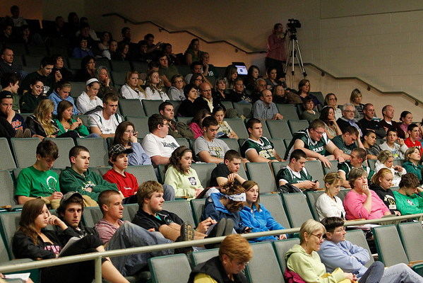 Record-Eagle/Jan-Michael Stump<br /> Audience members listen to Traverse City Area Public Schools Board members discuss potential budget cuts in the Traverse City West High School auditorium.