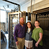 Record-Eagle/Dan Nielsen<br /> Ari Mokdad, center, plans to open wine bar Olives and Wine before Cherry Festival with Chien Nowland, left, and Jessica Korson, who will work as kitchen executive. The old bank vault is being remodeled into a lounge and wine cellar.