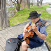 Record-Eagle/Keith King<br /> Francis Carew, of Traverse City, plays a Latin American classical guitar piece while sitting by Boardman Lake as he practices for upcoming local performances.