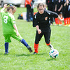 Record-Eagle/James Cook<br /> Elk Rapids' Emily Eckholt moves by a defender in a game against the River City Rascals.