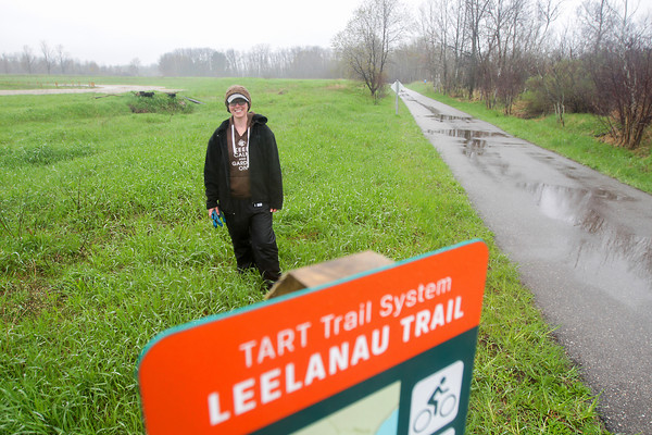 Record-Eagle/Keith King<br /> Samantha Graves, permaculturalist with Healing Tree Farm at DeYoung, stands along the Leelanau Trail in Elmwood Township.